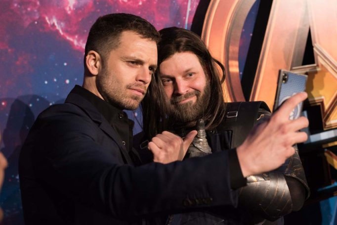 LONDON, ENGLAND - APRIL 08: Sebastian Stan (L) and Fan (R) attends the UK Fan Event to celebrate the release of Marvel Studios' 'Avengers: Infinity War' at The London Television Centre on April 8, 2018 in London, England.  (Photo by Gareth Cattermole/Gareth Cattermole/Getty Images for Disney)